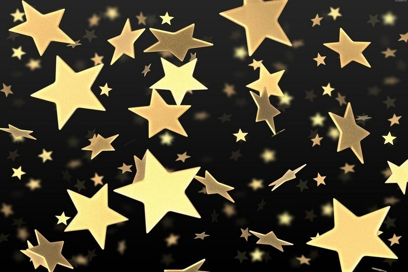 Gold stars against a black background