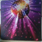 A disco ball backdrop